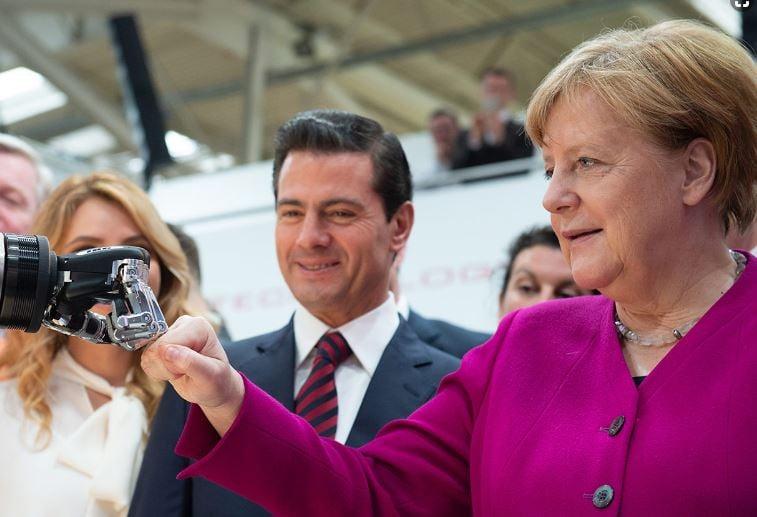 Angela Merkel greets the robot