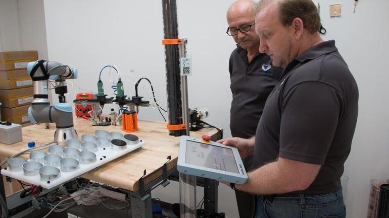 UR3 cobot handling the assembly