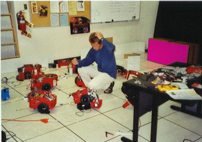 USC, Los Angeles, 2000 Esben is working with a group of Pioneer robots, as part of his research on multi-robot coordination.