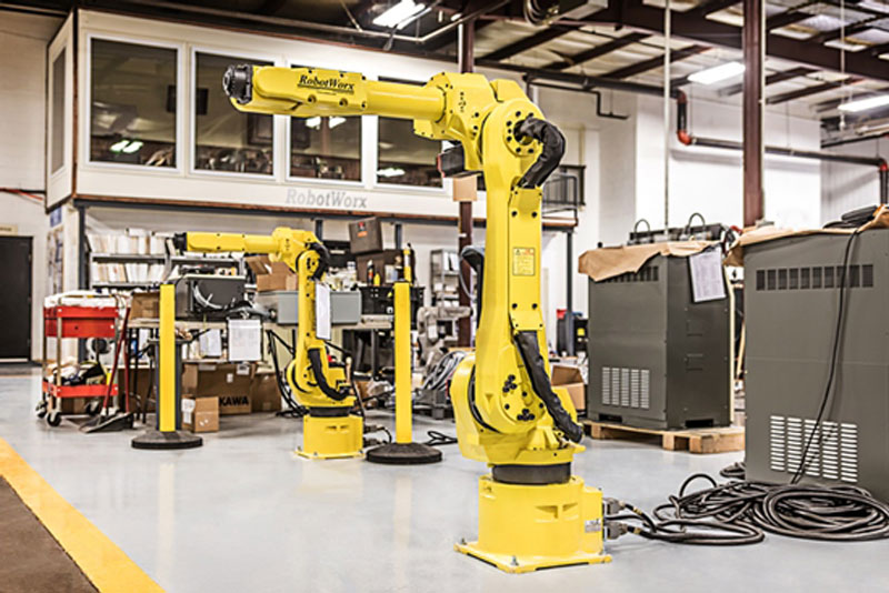 A traditional assembly robot uses a hydraulic robotic arm for industrial applications.