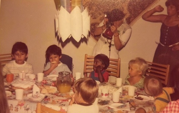 Esben (in green) at a birthday party in the Philippines around the time of his first robot