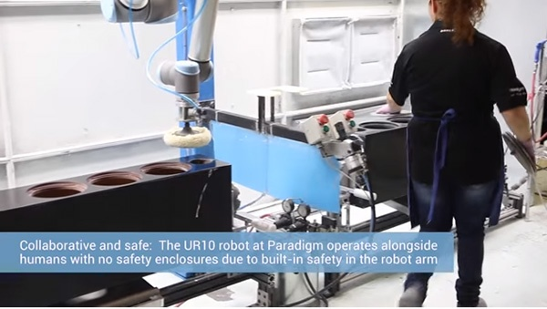 a-UR-robot-polishes-loudspeaker-cabinets-in-tandem-with-an-employee.jpg
