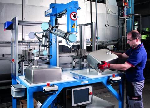 a UR5 robot now handling repetitive glue dispensing tasks.jpg